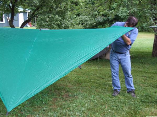 Attroll sets up his cocoon/tent
